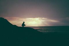 Cliff (Louis Dazy) Tags: ocean sunset cliff silhouette clouds sunrise dark island lights ray grain australia reflexion philip