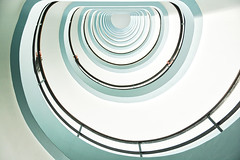 Going up? (Jochem.Herremans) Tags: city light white house abstract detail building art home glass up architecture modern stairs way circle spiral hotel design office high construction stair pattern view floor top background interior empty indoor down structure stairway indoors climbing step staircase round handrail inside swirl form concept curve shape circular