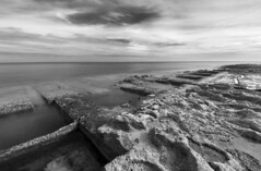 Rocky Shore (albireo 2006) Tags: sea blackandwhite bw seascape coast blackwhite cloudy horizon shoreline malta pb nb bn shore coastline seashore sliema blackandwhitephotos blackwhitephotos