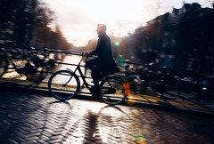 January sun (Rolling Spoke) Tags: street bridge sunset shadow blur reflection amsterdam bike bicycle cycling canal ride bokeh outdoor january streetphotography bicicleta cycle ciclismo bici pan velo jordaan fiets bisiklet