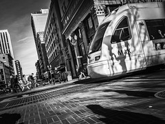 Light Rail City (TMimages PDX) Tags: road street city people urban blackandwhite monochrome train buildings portland geotagged photography photo image streetphotography streetscene sidewalk photograph transportation pedestrians pacificnorthwest lightrail streetcar avenue vignette fineartphotography iphoneography