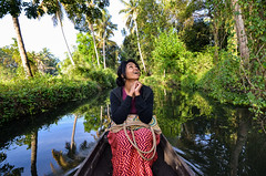This was the first time Harsha went around experiencing the place she belongs to. Her joy was infectious. (parmeetkohli) Tags: mist fish mountains coffee trek peace tea country lakes culture kerala jungle gods own toddy kathakali
