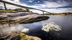 Nordra Straumsundet - Norway - Landscape photography (Giuseppe Milo (www.pixael.com)) Tags: longexposure travel bridge blue houses sea sky seascape motion green nature water norway clouds reflections landscape geotagged photography photo rocks europe no sony fullframe onsale ultrawide a7 hordaland sonya7 sonyfe1635