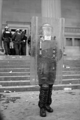 Riot Gear (the underlord) Tags: street slr film liverpool protest streetphotography police nikonf100 demonstration streetphoto shield protection limestreet riotgear merseyside stgeorgeshall ilfordfp4 kodakd76 nikkor35afd