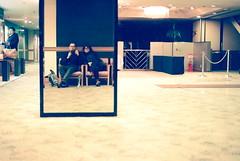 a drifting life (troutfactory) Tags: reflection film japan mirror friend  osaka analogue superia400 kansai hotellobby  selfie nikonf4   50mmnoktonf18