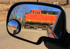 Objects in Mirror Are Closer Than They Appear (Conductor Cronk) Tags: railroad orange black reflection yellow train truck mirror crossing gates railway tags bnsf activated gevo es44ac