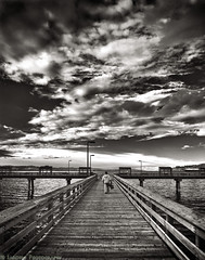 Going To Fish (mjardeen) Tags: sky blackandwhite bw white black water clouds contrast landscape ir pier washington pattern sony 28mm sound infrared wa converted f2 tacoma fe puget 282 a7ii 720nm lifepixel landscapesshotinportraitformat niksilverefex a7m2 ilce7m2
