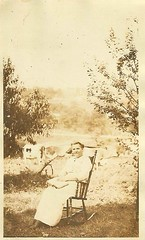 rural rocker reading and relaxing (912greens) Tags: trees rural outdoors reading women cows books rockingchairs rockers bucolic 1900s readers folksidontknow