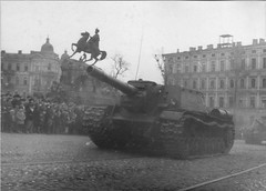 SU-152 move in a parade along Vladimirskaya street, past the monument to Hetman of Ukraine Bogdan Khmelnitsky on Sofiyskaya square in Kiev. May 1, 1945.
