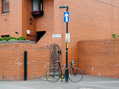 Bicycle #014 (Peter.Bartlett) Tags: city uk urban colour brick bike sign wall manchester gate unitedkingdom cycle m43 lunaphoto urbanarte vsco microfourthirds peterbartlett olympusomdem1 kodakportra160emulation