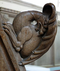 """An """"extraordinarily vicious griffin"""" serves as a handhold on the curved rail of the pulpit stairs, the Church of St Andrew, Cotton, Suffolk, England (Hunky Punk) Tags: wood uk england church carved suffolk gothic steps rail andrew medieval explore cotton gb griffin pulpit furnishings eastanglia decorated handhold"""