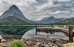 Awaiting the perfect paddle (BlueberryAsh) Tags: park lake mountains nikon kayak glacier national glaciernationalpark manyglacier nikon24120 nikond600 usa2015 manyglacierusanationalparklakemountaincanoeskyacklandscapeoutdoorsreflection