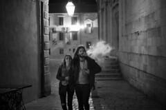 Blowing off some steam (Tmuussoni) Tags: street leica light shadow urban couple cigarette candid smoke snapshot leicasummiluxm50mmf14asph