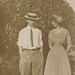 Young couple standing in the yard