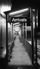Arrivals (Hammerhead27) Tags: blackandwhite bw sign modern night dark airport gate infinity empty corridor monotone international walkway welcome stark arrivals customs