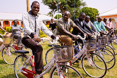 Uganda school staff receive new bicycles; high school on path to national accreditation (Peace Gospel) Tags: school light man men smile smiling bicycle happy hope education outdoor joy smiles happiness teacher bicycles transportation learning thankful grateful teaching teachers empowered joyful teach gratitude educate learn sustainability hopeful empowerment empower