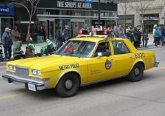 Big Yellow Taxi (Sean_Marshall) Tags: toronto plymouth police parade policecar chrysler metropolitan stpatricksday torontopoliceservice