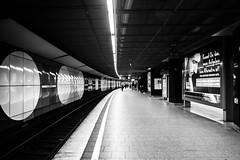"""Jungfernstieg  / """"Kennst Du das, wenn Aufgeben keine Alternative ist?"""" (*) (zgr Grgey) Tags: light bw reflection lines station subway nikon curves hamburg billboard d750 20mm voigtlnder jungfernstieg 2016"""