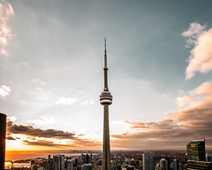 High Rise (colton.hall) Tags: street city roof sunset summer sky toronto ontario color colour art rooftop nature architecture clouds contrast cn landscape golden flickr cityscape cntower cloudy perspective sigma tones goldenhour cityline photooftheday streetsoftoronto flickroftheday