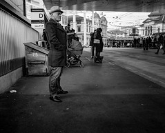 Breath and Exhale (pxlline) Tags: street urban bus hat station standing mono switzerland candid streetphotography posture zrich busstation pate ch filmnoir winterthur pixelline