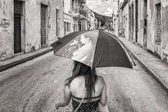sun protection (Gerard Koopen) Tags: life street blackandwhite bw woman blancoynegro monochrome umbrella walking fuji fotografie candid cuba streetphotography fujifilm fotography 2016 holguin sunprotection straatfotografie x100t gerardkoopen