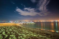 Mars (arnabjosephite) Tags: ocean blue light sea sky people reflection beach yellow clouds port stars sand singapore ships