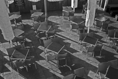 Lines and Squares (galanfor) Tags: camera white black film beach monochrome cafe chairs voigtlander bessa rangefinder delta 400 tables ilford paterns r2a