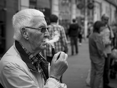 A Little Puff Of Smoke (Leanne Boulton) Tags: life street old city uk light shadow portrait people urban blackandwhite bw white man black detail male texture monochrome face canon 50mm mono scotland living blackwhite natural humanity bokeh outdoor expression glasgow candid smoke profile pipe culture streetphotography scene smoking depthoffield human elderly age shade portraiture 7d smoker society tone facial pipedreams candidstreetphotography