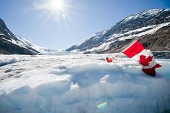 Athabasca Glacier in Jasper National Park (youtoo7725) Tags: sun mountain snow ice flag jaspernationalpark icefieldsparkway athabascaglacier