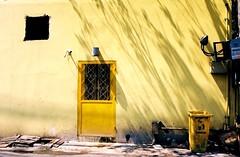 Thong Lo - Bangkok (jcbkk1956) Tags: street door film yellow wall analog 35mm thailand lemon nikon shadows kodak bangkok bin streetfurniture f80 nikkor thonglo
