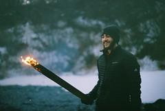 Sam n Fire (Rachael.Robinson) Tags: winter light canada man color film 35mm island fire flames bonfire fujifilm stick sparks campobello