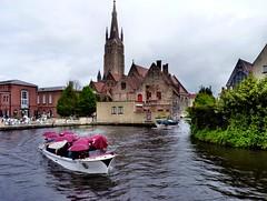 Bruges - Canal (Martin M. Miles) Tags: canal belgium brugge bruges umbrellas hanse westflanders onzelievevrouwekerk veniceofthenorth hanseaticleague bruegge cogship flemishregion brickworktower