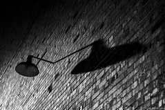 """A Long Shadow"" (D A Baker) Tags: ft fort wayne indiana allen county black white bw light lamp shadow brick building urban nikon d300 1755mm 28 daniel baker da"