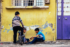 IMG_3962.JPG (esintu) Tags: door playing game boys bike bicycle yellow wall kids turkey children purple gaziantep