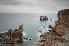 Millions Years Ago (MANUELup) Tags: ocean longexposure sea cloud seascape man nature water silhouette rock landscape rockies person spain gate natural cloudy horizon peaceful naturallight calm cliffs seashore cantabria waterscape liencres pielagos losurros