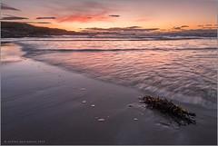 Moray Sunset (Andrew Paul Watson) Tags: longexposure sunset red orange beach clouds bay scotland cove tide filter fujifilm f28 moray foreground firth nisi 14mm covebay xt1 seawedd