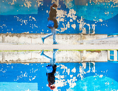 Blue as a Girl Can Be (marcin baran) Tags: street city blue urban streets color reflection building girl walking puddle person fuji walk streetphotography blues poland polska reflect human fujifilm streetphoto deteriorated fasade gliwice x100 fujix100 marcinbaran x100t