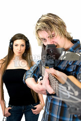 Guitar Gun (the UMF) Tags: blue people music white black color male men vertical female women adult guitar expression longhair indoors whitebackground photograph sound instrument headphones string studioshot copyspace youngadult twopeople isolated frontview 20s caucasian shallowdepthoffield squinting youthculture youngwomen youngmen realpeople 2025years singleobject plainbackground isolatedonwhite