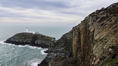 the great yearning for the Sea (lunaryuna) Tags: light sea sky panorama cliff lighthouse seascape beauty weather wales landscape coast rocks solitude wake waves mood elements isolation lunaryuna northwales southstack harshness angleseyisland mellowness holyheadlighthouse