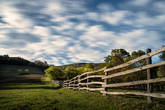 Spring dance (petkovskiot) Tags: ranch wood longexposure blue sky green nature grass clouds fence wonderful landscape countryside movement village beautyinnature naturephotograph