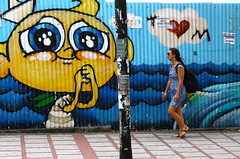 Please love me (Alex L'aventurier,) Tags: life street city people urban woman art canon painting walking movement costarica mural candid femme cartoon sanjose rue ville mouvement urbain murale marcher