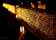 Bokeh Overflow (zouberiphotography) Tags: christmas city travel bridge winter light urban travelling salzburg tourism field yellow architecture night river dark 50mm gold lights austria golden town sterreich nikon december dof nightshot bokeh depthoffield nighttime depth oesterreich salzach d90 zouberi