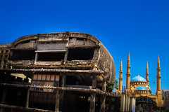 The Egg facing Mohammad Al Amin Mosque, Marfaa, Beirut (berengere.cavalier) Tags: abandonned abandonnedcinema abandonnedtheatre alamine arab arabic architectural architecture asia attraction beirut beyrouth blue bluemosque bluesky building cinema city color colorimage colour concrete contrast damaged destination dom dome downtown egg historical history holy horizontal islam islamic juxtaposed landmark lebanese lebanon liban lifestyle middle middleeast minaret minarets mohammadalaminmosque monument mosque muhammad muslim ottoman outdoor placeofworship pray praying religion shia shiite sky style suni sunni sunnimosque theegg theatre tourism tourist travel unfinished war worship