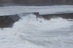 Storm wave hitting the tetrapods and the giant rocks placed to protect the Wick lighthouse pier. (Shandchem) Tags: storm bay scotland waves harbour gale wick caithness tetrapods