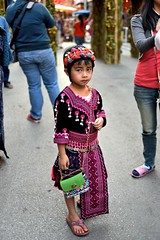 Hmong child (jeremyhughes) Tags: street red black thailand child purple embroidery sandals crafts traditional culture celebration chiangmai traditionalcostume handbag embroidered poise hmong headdress