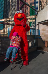 Las Vegas | The Strip | Relunctant and Responsive (Facundity) Tags: red costume child lasvegas outdoor candid character nevada elmo streetphotography shy nyny streetcandid canoneos70d