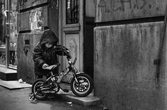 35/365 (goran1101) Tags: street city people urban blackandwhite bw monochrome bike bicycle contrast 35mm kid nikon toddler outdoor candid serbia belgrade moment decisivemoment project365 d5100