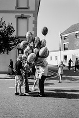 Balloon Seller (gwpics) Tags: blackandwhite bw monochrome balloons mono blackwhite balloon streetphotography lifestyle hampshire society socialdocumentary socialcomment emsworth hants streetpics strasenfotograpfie