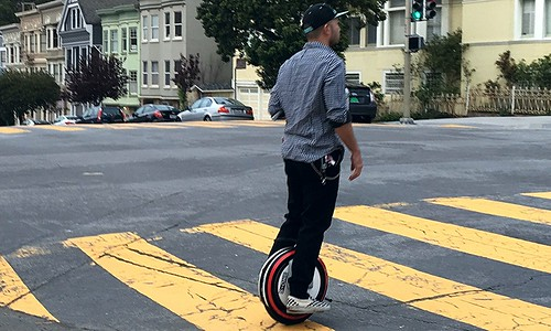 Fashion Hipster Mono Scoots Across on One Wheel Thing That Looks Like a Unicycle Now Called Self Balancing Electric Monocycle