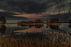 The charm of nightfall 3 (piotrekfil) Tags: trees sunset sky moon lake nature water clouds reflections landscape island twilight pentax dusk poland waterscape piotrfil